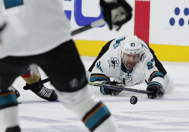 San Jose Sharks right wing Joonas Donskoi (27) tries to pass against the Vegas Golden Knights during the second period in Game 6 of a first-round NHL hockey playoff series Sunday, April 21, 2019, in Las Vegas. (AP Photo/John Locher)