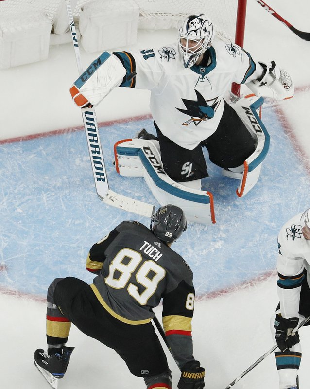 San Jose Sharks goaltender Martin Jones (31) blocks a shot against the Vegas Golden Knights during the second overtime in Game 6 of a first-round NHL hockey playoff series Sunday, April 21, 2019, in Las Vegas. (AP Photo/John Locher)