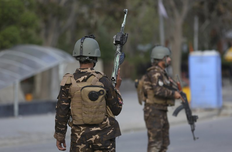 Afghan Security personnel arrive outside the Telecommunication Ministry during a gunfight with insurgents in Kabul, Afghanistan, Saturday, April 20, 2019. (AP Photo/Rahmat Gul)
