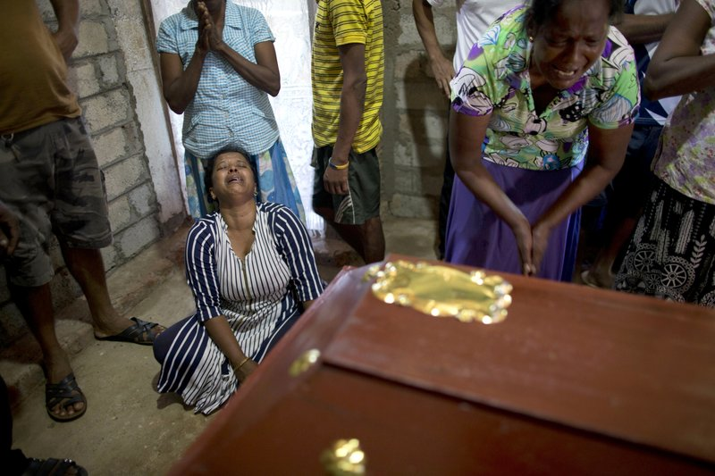 Relatives cry near the coffin with the remains of 12-year Sneha Savindi, who was a victim of Easter Sunday bombing at St. (AP Photo/Gemunu Amarasinghe)