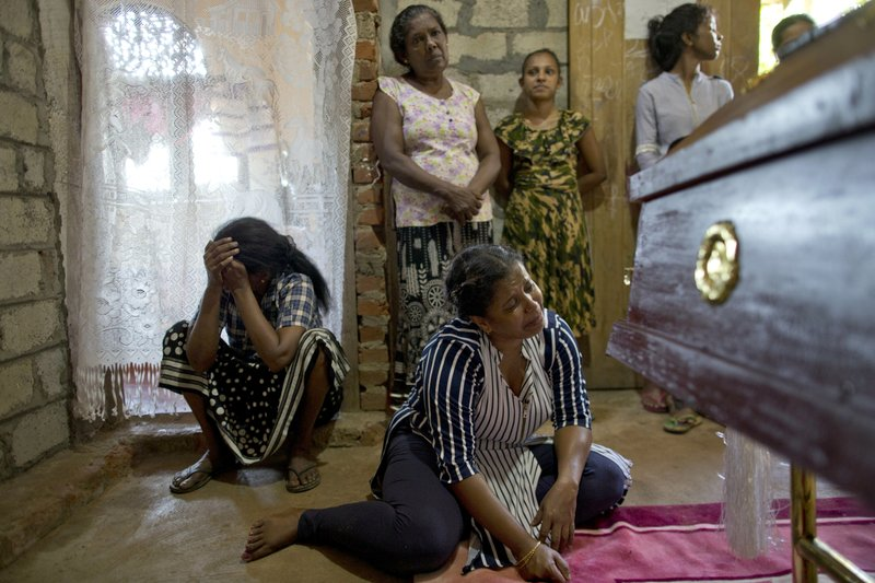 Relatives weep near the coffin with the remains of 12-year Sneha Savindi, who was a victim of Easter Sunday bombing at St. (AP Photo/Gemunu Amarasinghe)