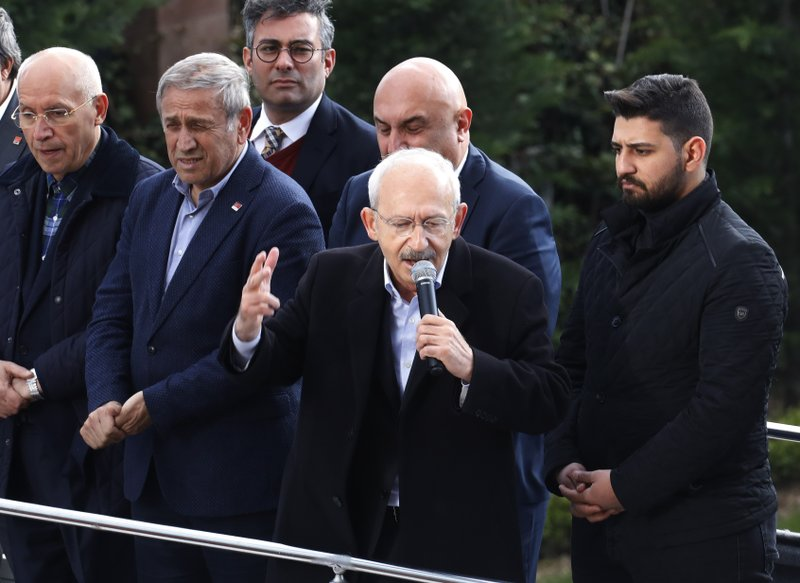 Kemal Kilicdaroglu, the leader of Turkey's main opposition Republican People's Party, CHP, addresses CHP members after being attacked during the funeral of a soldier who was slain during clashes with Kurdish rebels at Iraq border, in Ankara, Turkey, Sunday, April 21, 201. (AP Photo/Burhan Ozbilici)
