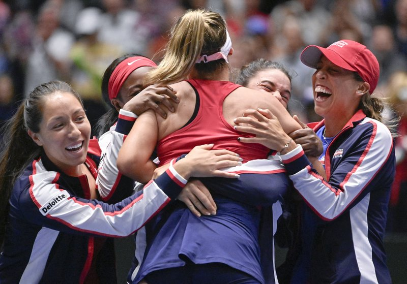 United States' Sofia Kenin, center, is congratulated by her teammates after defeating Switzerland's Timea Bacsinszky in a tie breaker, after their playoff-round Fed Cup tennis match, Sunday, April 21, 2019, in San Antonio. (AP Photo/Darren Abate)