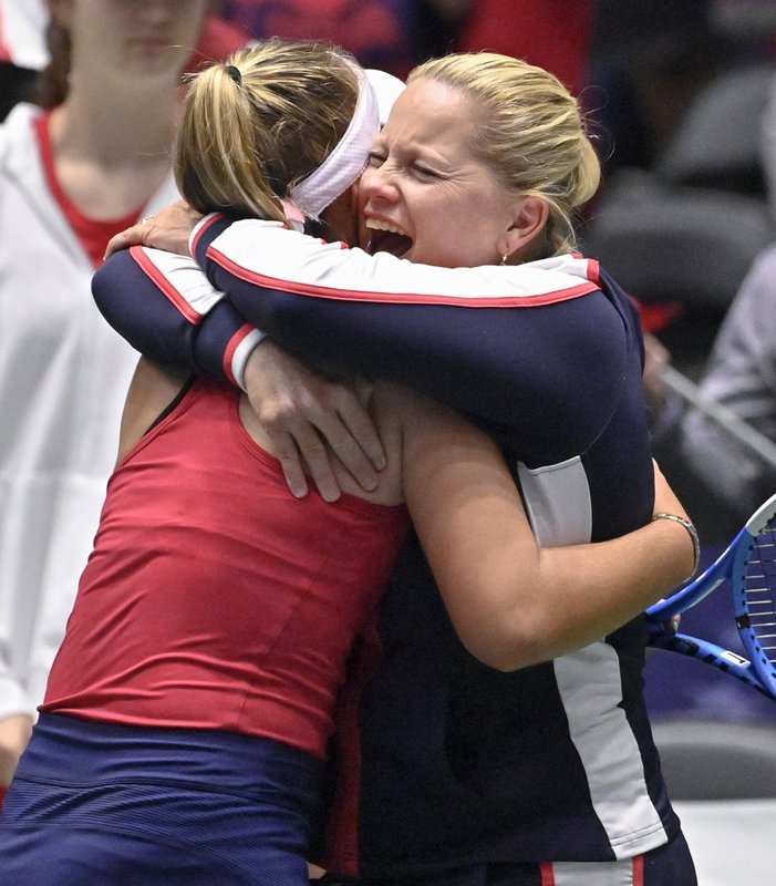 United States captain Kathy Rinaldi, right, hugs player Sofia Kenin after her win against Switzerland's Timea Bacsinszky, after their playoff-round Fed Cup tennis match, Sunday, April 21, 2019, in San Antonio. (AP Photo/Darren Abate)