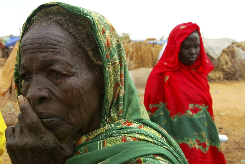 FILE - In this July 1, 2004 file photo, displaced Sudanese women at the Zam Zam refugee camp are seen just outside the town of El-Fashir in the Darfour region of Sudan during a visit by U. (AP Photo/Karel Prinsloo, File)