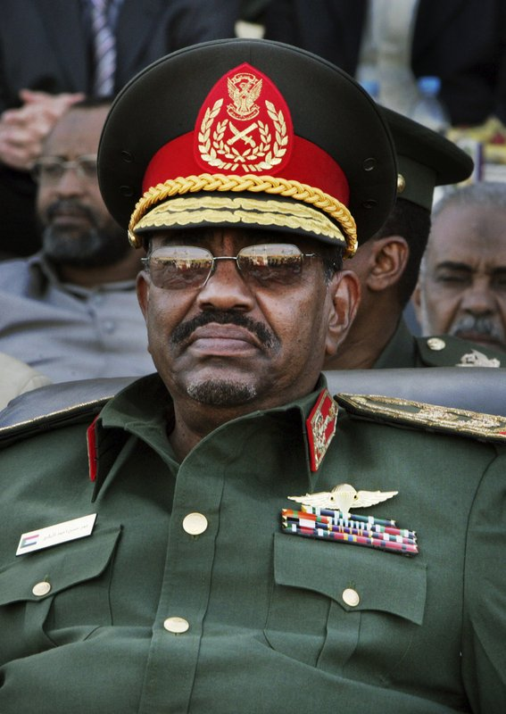 FILE - In this March 4, 2009 file photo, Sudanese President Omar al-Bashir attends a graduation ceremony at an air force academy near Khartoum, Sudan. (AP Photo/Abd Raouf, File)