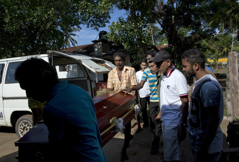 People carry the coffin with the remains of 12-year Sneha Savindi, who was a victim of Easter Sunday bombing at St. (AP Photo/Gemunu Amarasinghe)