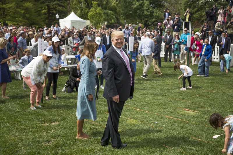 President Donald Trump and first lady Melania Trump attend the annual White House Easter Egg Roll on the South Lawn of the White House, Monday, April 22, 2019, in Washington. (AP Photo/Andrew Harnik)