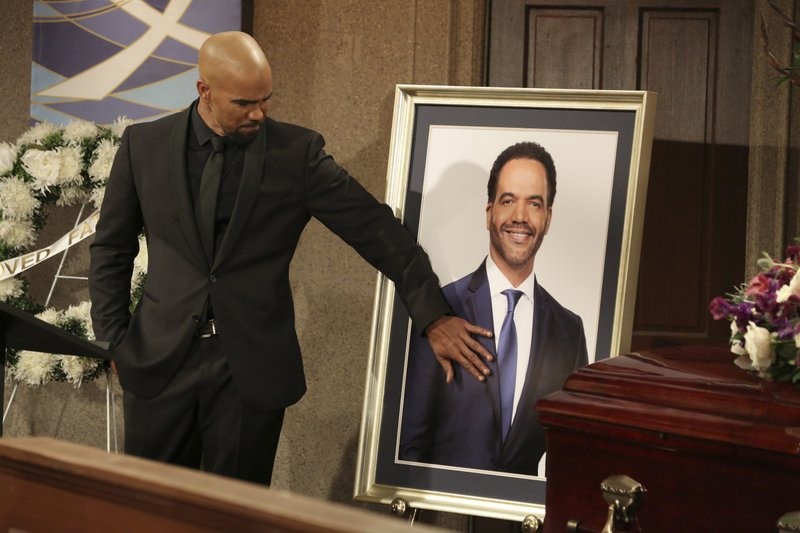 CORRECTS CHARACTER NAME FROM MORGAN TO WINTERS - This image released by CBS shows Shemar Moore portraying Malcolm Winters during a funeral scene for the character Neil Winters, portrayed by the late actor Kristoff St. (Michael Yarish/CBS via AP)