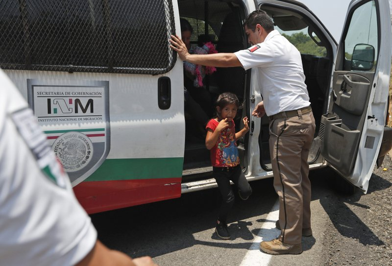 A Central American migrant child cries as she is asked to get into an immigration vehicle as she is detained on the highway to Pijijiapan, Mexico, Monday, April 22, 2019. (AP Photo/Moises Castillo)