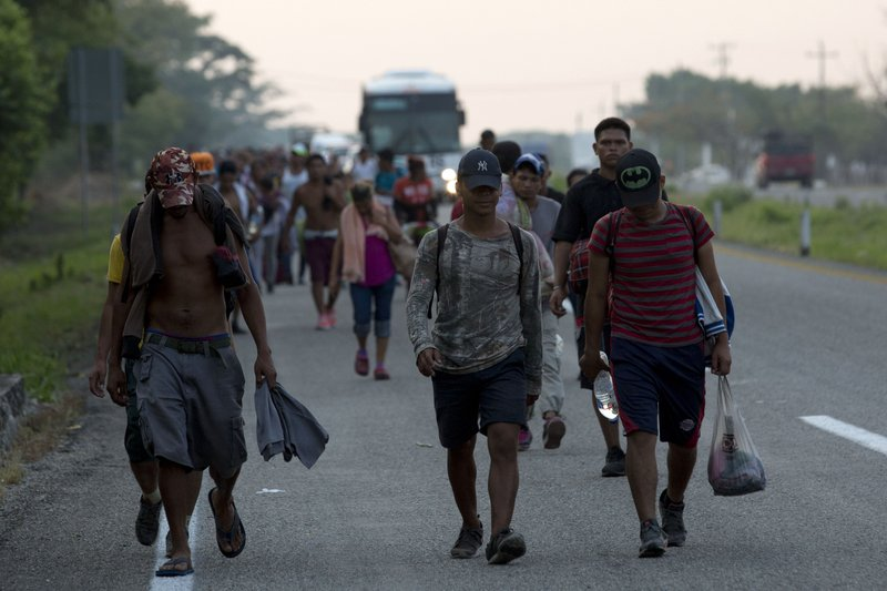 Central American migrants traveling in a caravan to the U.S. border walk on the highway to Pijijiapan, Mexico, Monday, April 22, 2019. (AP Photo/Moises Castillo)