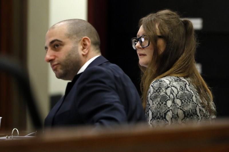 Attorney Todd Spodek and Anna Sorokin sit at the defense table during her trial at New York State Supreme Court, in New York, Monday, April 22, 2019. (AP Photo/Richard Drew)