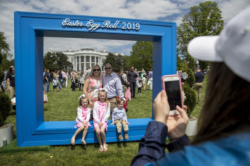 Guests take photos at the annual White House Easter Egg Roll on the South Lawn of the White House, Monday, April 22, 2019, in Washington. (AP Photo/Andrew Harnik)