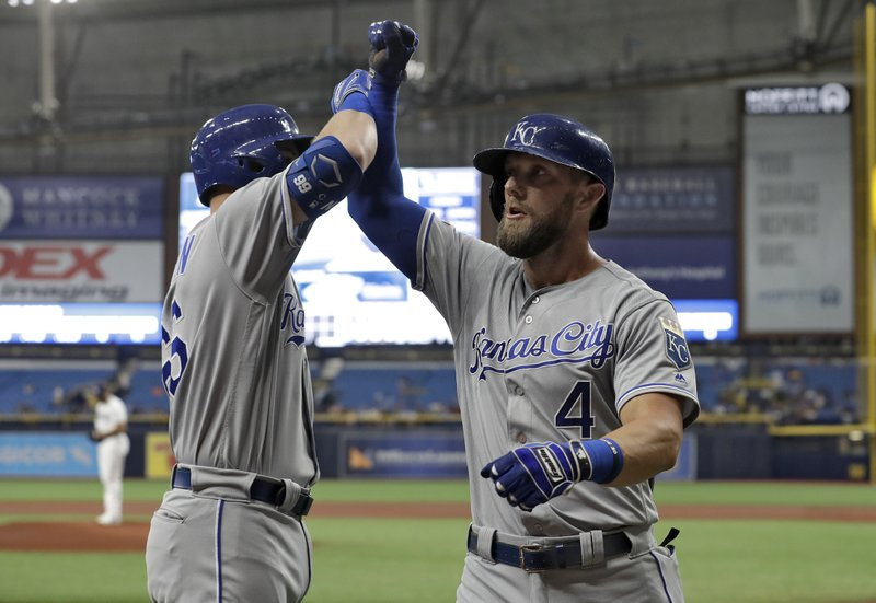 Kansas City Royals' Alex Gordon (4) celebrates his home run off Tampa Bay Rays pitcher Yonny Chirinos with Ryan O'Hearn during the first inning of a baseball game Monday, April 22, 2019, in St. (AP Photo/Chris O'Meara)