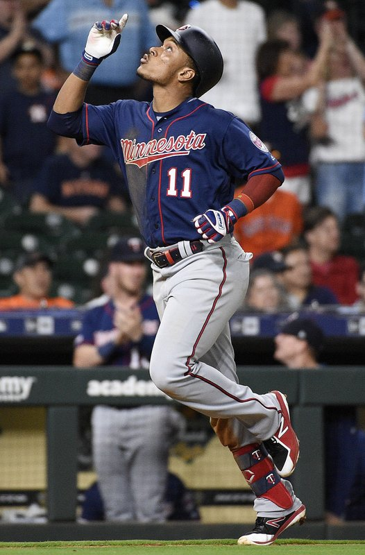 Minnesota Twins' Jorge Polanco reacts after hitting a two-run home run off Houston Astros relief pitcher Chris Devenski during the eighth inning of a baseball game, Monday, April 22, 2019, in Houston. (AP Photo/Eric Christian Smith)