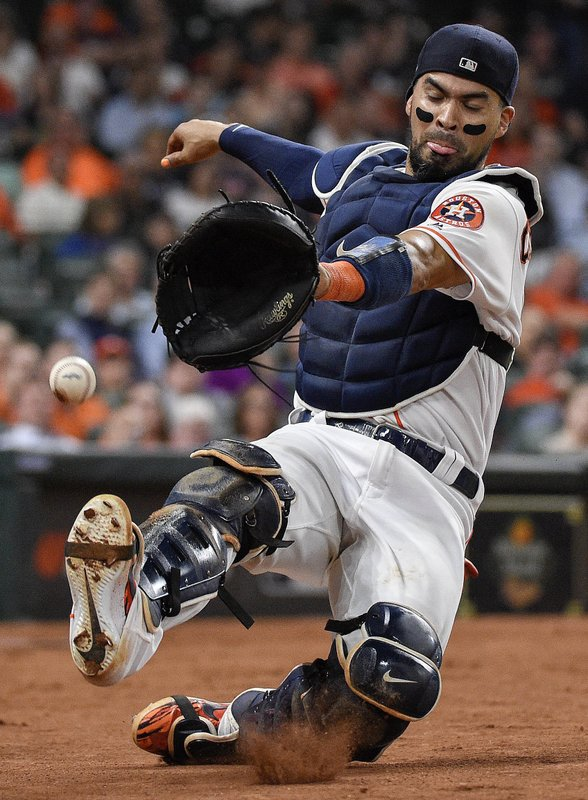 Houston Astros catcher Robinson Chirinos misses the foul ball of Minnesota Twins' Jonathan Schoop during the sixth inning of a baseball game, Monday, April 22, 2019, in Houston. (AP Photo/Eric Christian Smith)