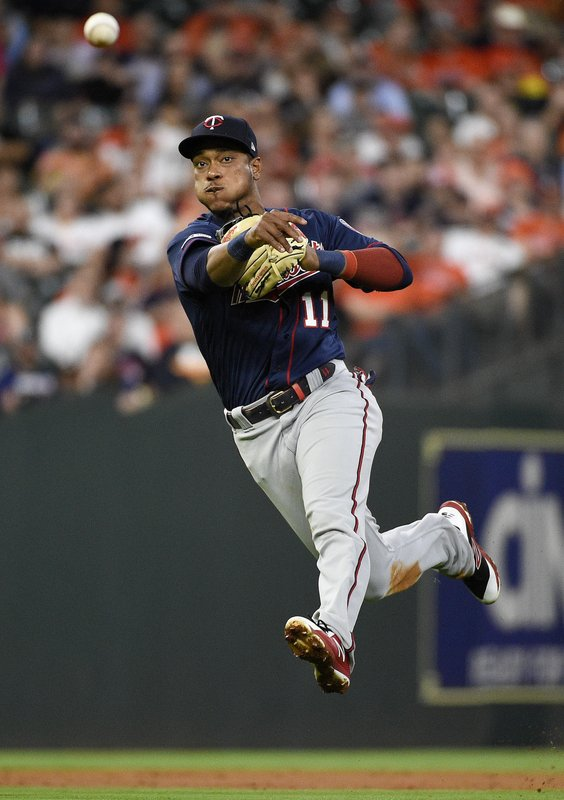 Minnesota Twins shortstop Jorge Polanco throws out Houston Astros' Jose Altuve during the third inning of a baseball game, Monday, April 22, 2019, in Houston. (AP Photo/Eric Christian Smith)