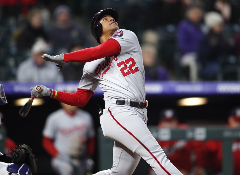 Washington Nationals' Juan Soto fouls out against the Colorado Rockies in the third inning of a baseball game Monday, April 22, 2019, in Denver. (AP Photo/David Zalubowski)