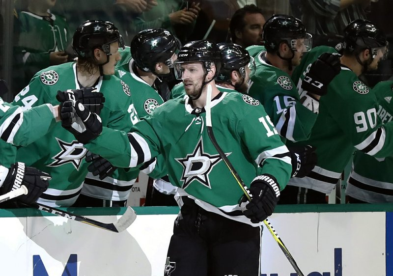 Dallas Stars left wing Blake Comeau (15) is congratulated by the bench after his goal against the Nashville Predators in the second period of Game 6 in an NHL hockey first-round playoff series in Dallas, Monday, April 22, 2019. (AP Photo/Tony Gutierrez)