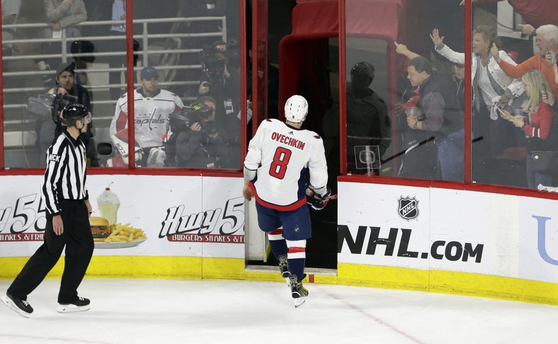 Washington Capitals' Alex Ovechkin (8), off Russia, leaves the ice following a penalty during the third period of Game 6 of an NHL hockey first-round playoff series against the Carolina Hurricanes in Raleigh, N. (AP Photo/Gerry Broome)