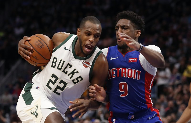 Milwaukee Bucks forward Khris Middleton (22) is defended by Detroit Pistons guard Langston Galloway (9) during the first half of Game 4 of a first-round NBA basketball playoff series, Monday, April 22, 2019, in Detroit. (AP Photo/Carlos Osorio)