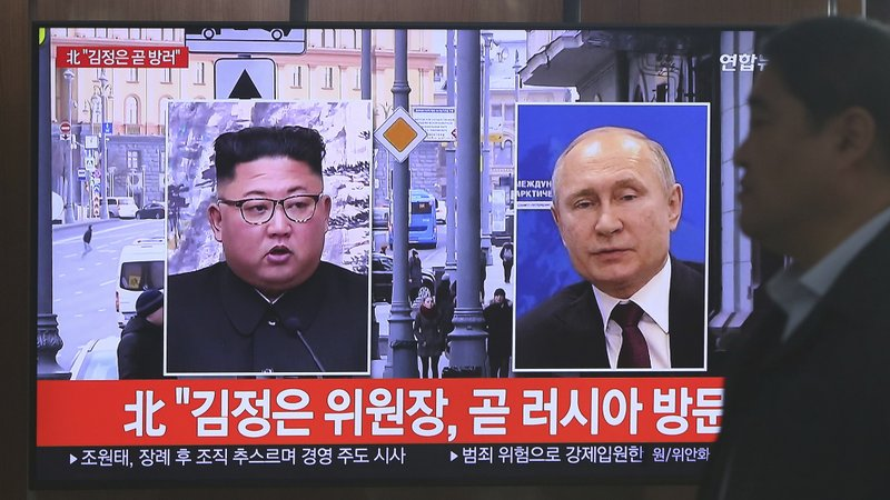 A man passes by a TV screen showing images of North Korean leader Kim Jong Un, left, and Russian President Vladimir Putin, right, during a news program at the Seoul Railway Station in Seoul, South Korea, Tuesday, April 23, 2019. (AP Photo/Ahn Young-joon)