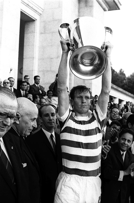FILE - In this May 25, 1967 file photo Celtic soccer team captain Billy McNeill holds aloft the European Cup after it was presented by Portugal's President Americo Tomaz, left, in Lisbon, Portugal. (AP Photo, File)
