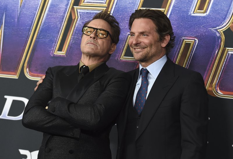 Robert Downey Jr., left, and Bradley Cooper arrive at the premiere of