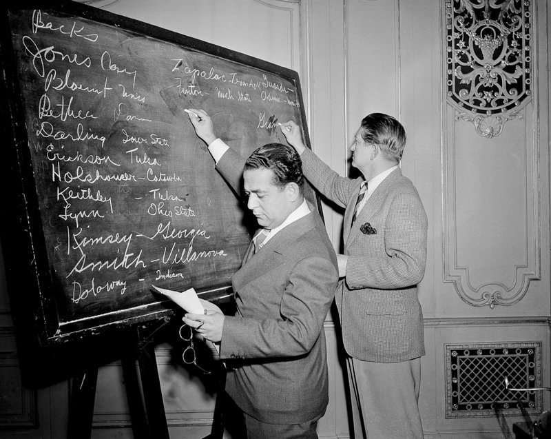 FILE - In this April 18, 1943, file photo, Fred Mandel, foreground, president of the Detroit Lions, and Charles