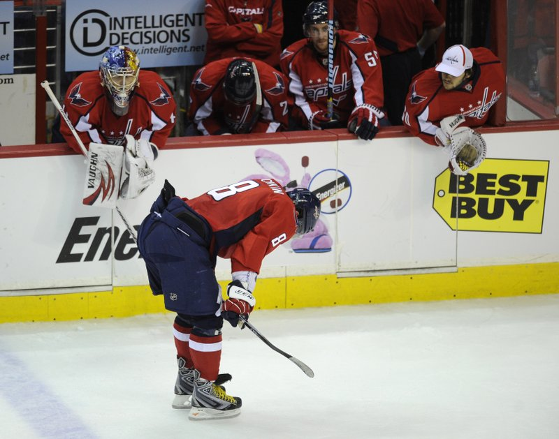 FILE - In this April 28, 2010, file photo, Washington Capitals left wing Alex Ovechkin (8), of Russia, skates with his head down after the Capitals lost to the Montreal Canadiens 2-1 in Game 7 of the NHL hockey playoff series, in Washington. (AP Photo/Nick Wass, File)