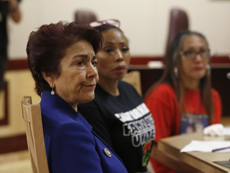 State Sen. Anna Caballero, D-Salinas, left, listens as members of the Senate Public Safety Committee discusses her police-backed law enforcement training bill during a hearing at the Capitol Tuesday, April 23, 2019, in Sacramento, Calif. (AP Photo/Rich Pedroncelli)
