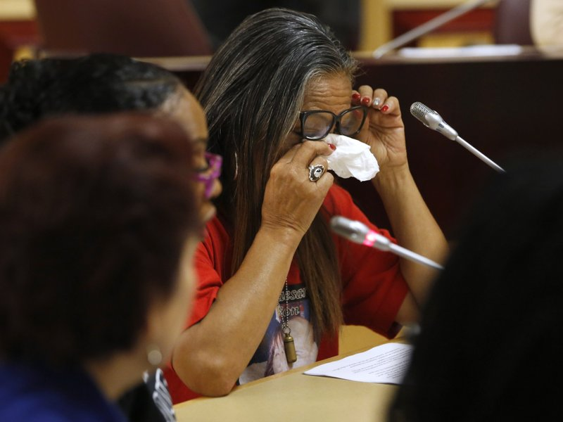 Theresa Smith, right, the mother of Caesar Cruz, who was killed in a confrontation with police, wipes her eyes after testifying against a police-backed law enforcement training bill by state Sen. (AP Photo/Rich Pedroncelli)