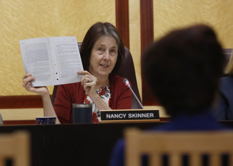 State Sen. Nancy Skinner, D-Berkeley, chairwoman of the Senate public safety committee, displays a copy of Democratic state Sen. (AP Photo/Rich Pedroncelli)