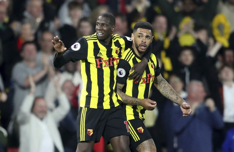 Watford's Andre Gray, right, celebrates scoring his side's first goal of the game against Southampton, during their English Premier League soccer match at Vicarage Road in Watford, London, England, Tuesday April 23, 2019. (Adam Davy/PA via AP)