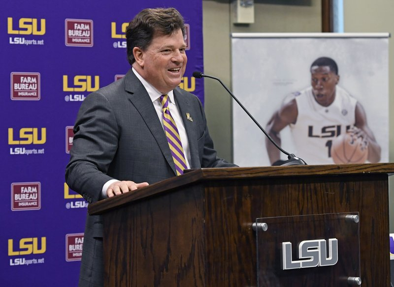Scott Woodward answers questions after being introduced as the new Director of Athletics at LSU, Tuesday April 23, 2019, in Baton Rouge, La. (Bill Feig/The Advocate via AP)