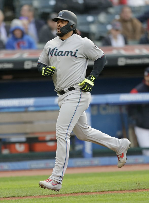 Miami Marlins' Jorge Alfaro runs the bases after hitting a solo home run off Cleveland Indians relief pitcher Neil Ramirez in the fifth inning of a baseball game, Tuesday, April 23, 2019, in Cleveland. (AP Photo/Tony Dejak)