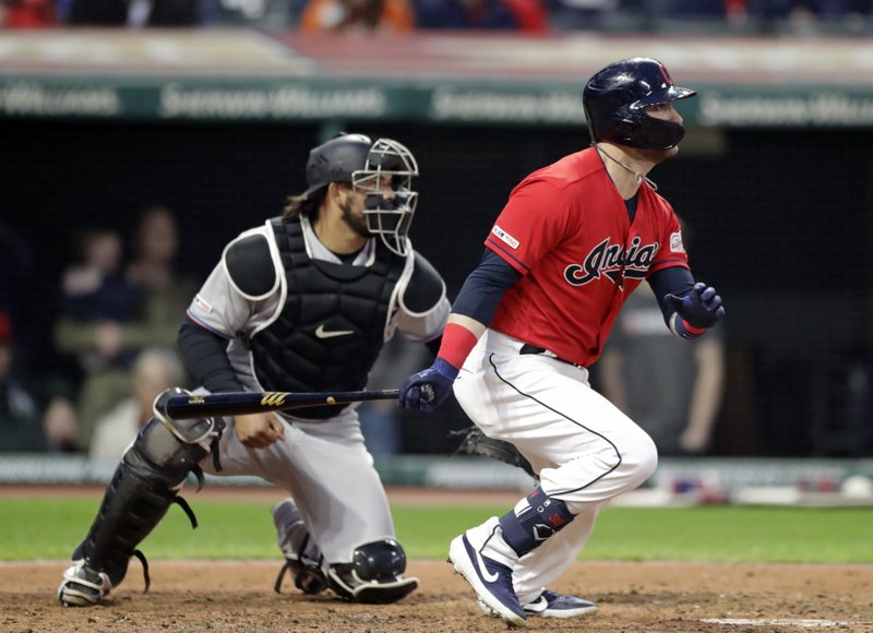 Cleveland Indians' Tyler Naquin watches his ball after hitting an RBI-single in the seventh inning of a baseball game against the Miami Marlins, Tuesday, April 23, 2019, in Cleveland. (AP Photo/Tony Dejak)