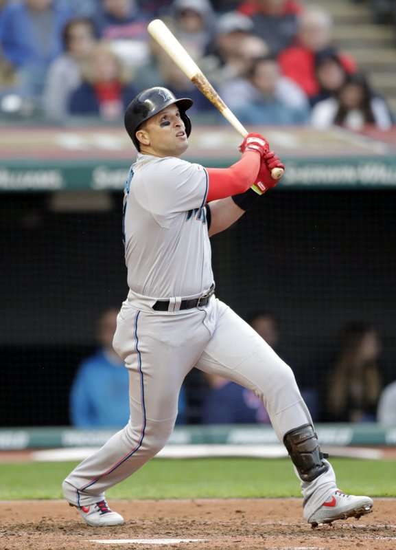 Miami Marlins' Martin Prado watches his ball after hitting a sacrifice fly in the fifth inning of a baseball game against the Cleveland Indians, Tuesday, April 23, 2019, in Cleveland. (AP Photo/Tony Dejak)