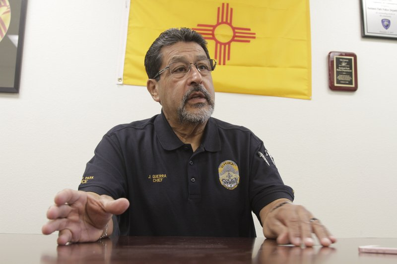 Sunland Park Police Chief Javier Guerra speaks from his headquarters in Sunland Park, N.M., Tuesday, April 23, 2019. (AP Photo/Cedar Attanasio)