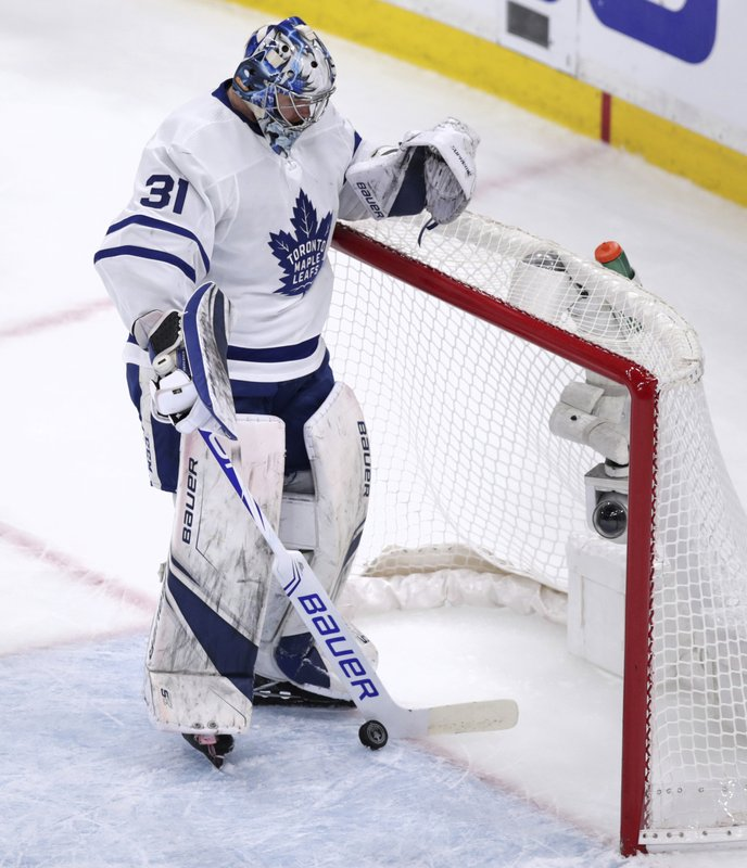 Toronto Maple Leafs goaltender Frederik Andersen (31) retrieves the puck from the net after a goal by Boston Bruins left wing Marcus Johansson during the first period of Game 7 of an NHL hockey first-round playoff series, Tuesday, April 23, 2019, in Boston. (AP Photo/Charles Krupa)