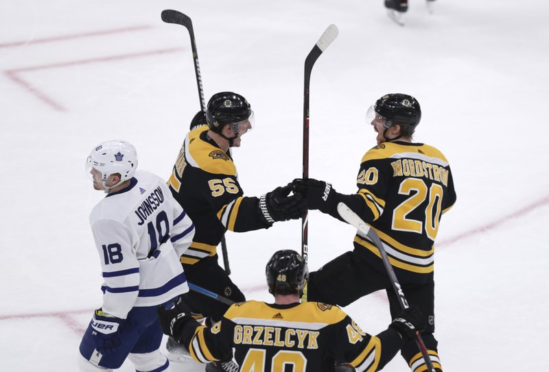 Boston Bruins center Joakim Nordstrom (20) is congratulated by Noel Acciari (55) after his goal against the Toronto Maple Leafs during the first period of Game 7 of an NHL hockey first-round playoff series, Tuesday, April 23, 2019, in Boston. (18), in foreground is Boston Bruins defenseman Matt Grzelcyk (48). (AP Photo/Charles Krupa)