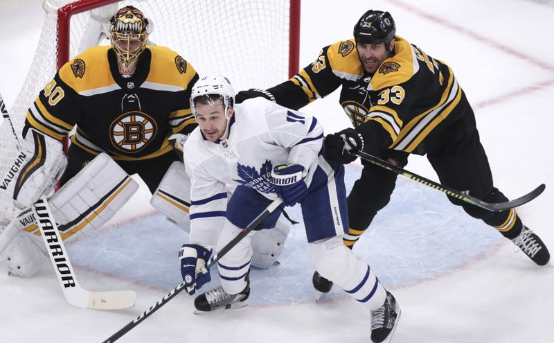 Boston Bruins defenseman Zdeno Chara (33) tries to clear Toronto Maple Leafs left wing Zach Hyman (11) away from goalie Tuukka Rask during the first period of Game 7 of an NHL hockey first-round playoff series, Tuesday, April 23, 2019, in Boston. (AP Photo/Charles Krupa)