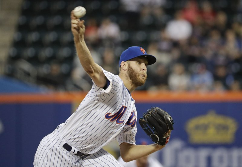 New York Mets' Zack Wheeler delivers a pitch during the first inning of a baseball game against the Philadelphia Phillies, Tuesday, April 23, 2019, in New York. (AP Photo/Frank Franklin II)