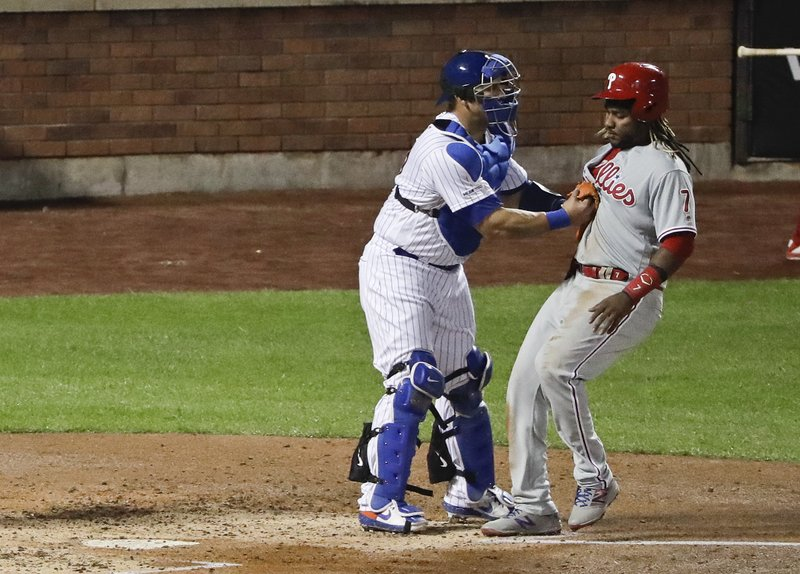 New York Mets catcher Wilson Ramos (40) tags out Philadelphia Phillies' Maikel Franco (7) before he reaches home plate during the fourth inning of a baseball game Tuesday, April 23, 2019, in New York. (AP Photo/Frank Franklin II)