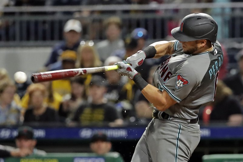 Arizona Diamondbacks' David Peralta drives in a run with a fielder's choice off Pittsburgh Pirates starting pitcher Trevor Williams during the sixth inning of a baseball game in Pittsburgh, Tuesday, April 23, 2019. (AP Photo/Gene J. Puskar)