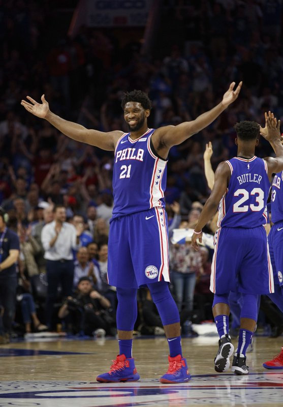 Philadelphia 76ers' Joel Embiid, of Cameroon, reacts to his basket during the first half in Game 5 of a first-round NBA basketball playoff series against the Brooklyn Nets, Tuesday, April 23, 2019, in Philadelphia. (AP Photo/Chris Szagola)