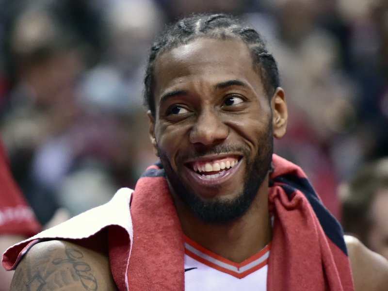 Toronto Raptors forward Kawhi Leonard (2) smiles from the bench during a late second half timeout in Game 5 of a first-round NBA basketball playoff series against the Orlando Magic, Tuesday, April 23, 2019 in Toronto. (Frank Gunn/Canadian Press via AP)