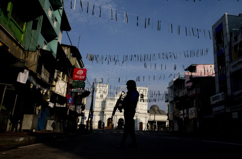 A security officer stands guard outside St. Anthony's Shrine where bombing was carried out on Easter Sunday, in Colombo, Sri Lanka, Wednesday, April 24, 2019. (AP Photo/Gemunu Amarasinghe)