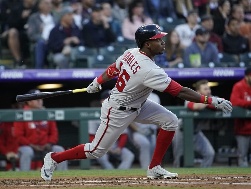 Washington Nationals' Victor Robles watches the flight of a three RBI double hit off Colorado Rockies starting pitcher Jeff Hoffman during the third inning of a baseball game Tuesday, April 23, 2019, in Denver. (AP Photo/Jack Dempsey)