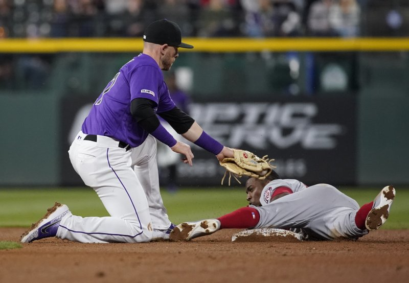 Washington Nationals' Victor Robles is safe at second on a steal as Colorado Rockies shortstop Trevor Story (27) covers during the fifth inning of a baseball game Tuesday, April 23, 2019, in Denver. (AP Photo/Jack Dempsey)